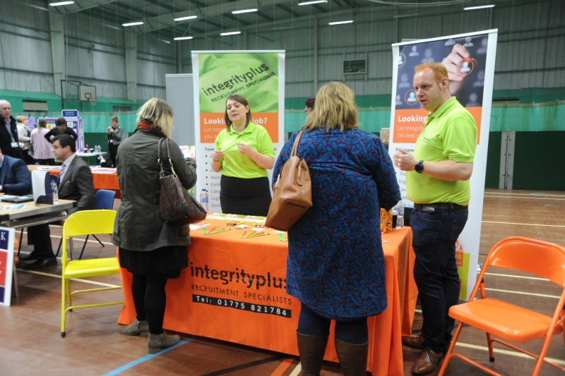 Carly Chapman and Lee Dickings of Integrity speaks to the public at the South Holland Jobs Fair.