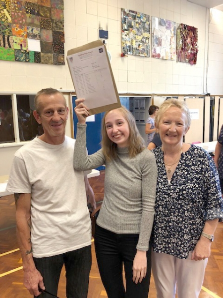 A delighted Chelsie Wainwright picked up nearly perfect all nines and one eight. She's pictured here with proud parents Fiona and Jimmy. Spalding High School GCSE Results Day 2018