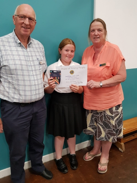 Walking Tall Award winner Ellie-Mae Dolby from Spalding St Paul's School, with Lion John Steel and Lion Eileen Robson.