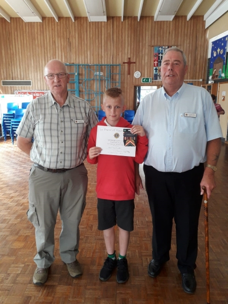 Brandon Elderkin from St. Bartholomew's School with Lion John Steel and Lion Richard Briers