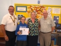 Winner Megan Booth from Weston Hills School with Lion President Stuart East and Lion Eileen Robson, Lion John Steel.