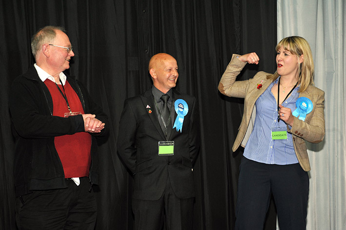 Laura Eldridge celebrates becoming a councillor for Long Sutton, watched by fellow elected Conservative and Father Jonathan Sibley (representing wife Jeanne, an Independent candidate).