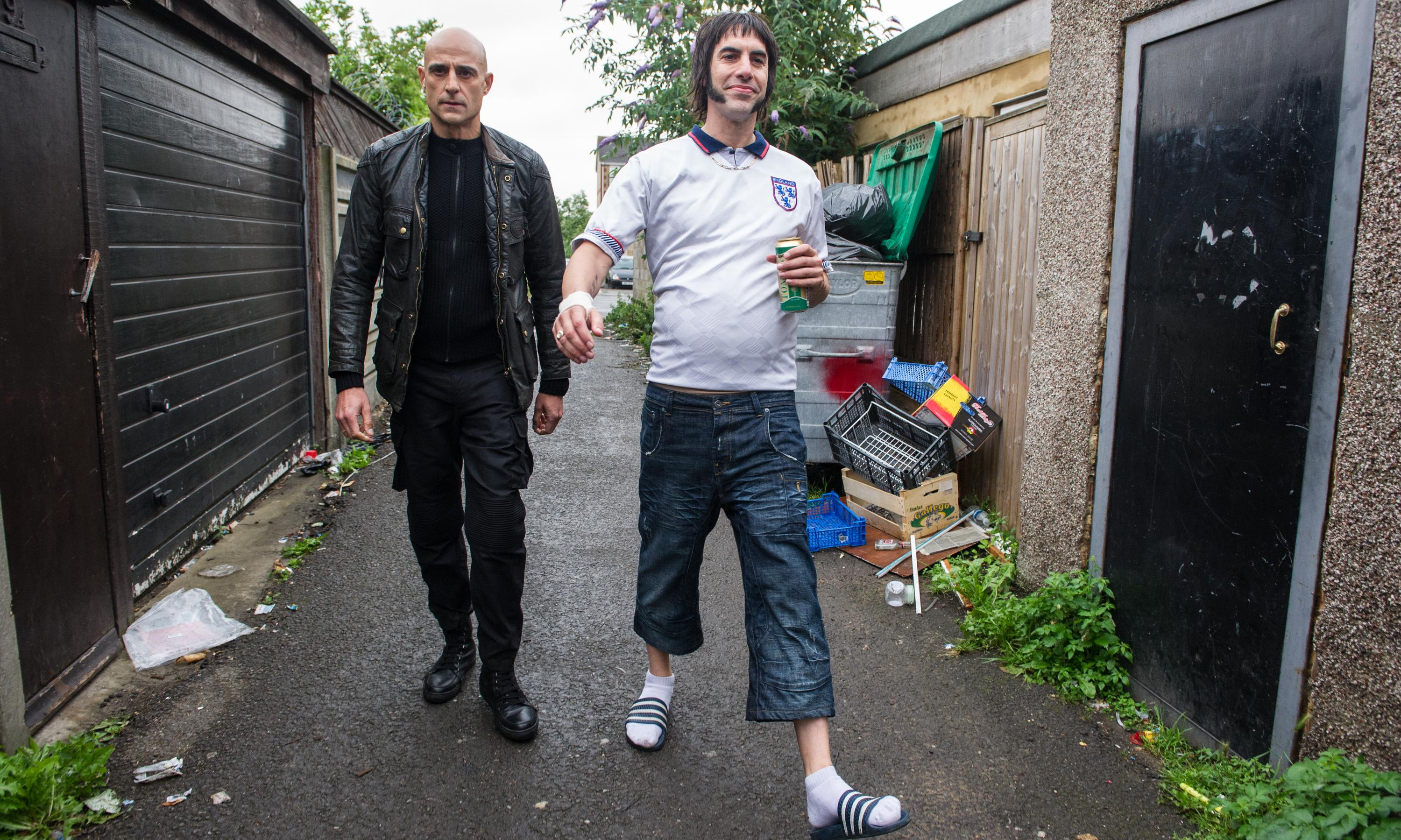 POLAR OPPOSITES: Mark Strong and Sacha Baron Cohen play very different characters in Grimsby.